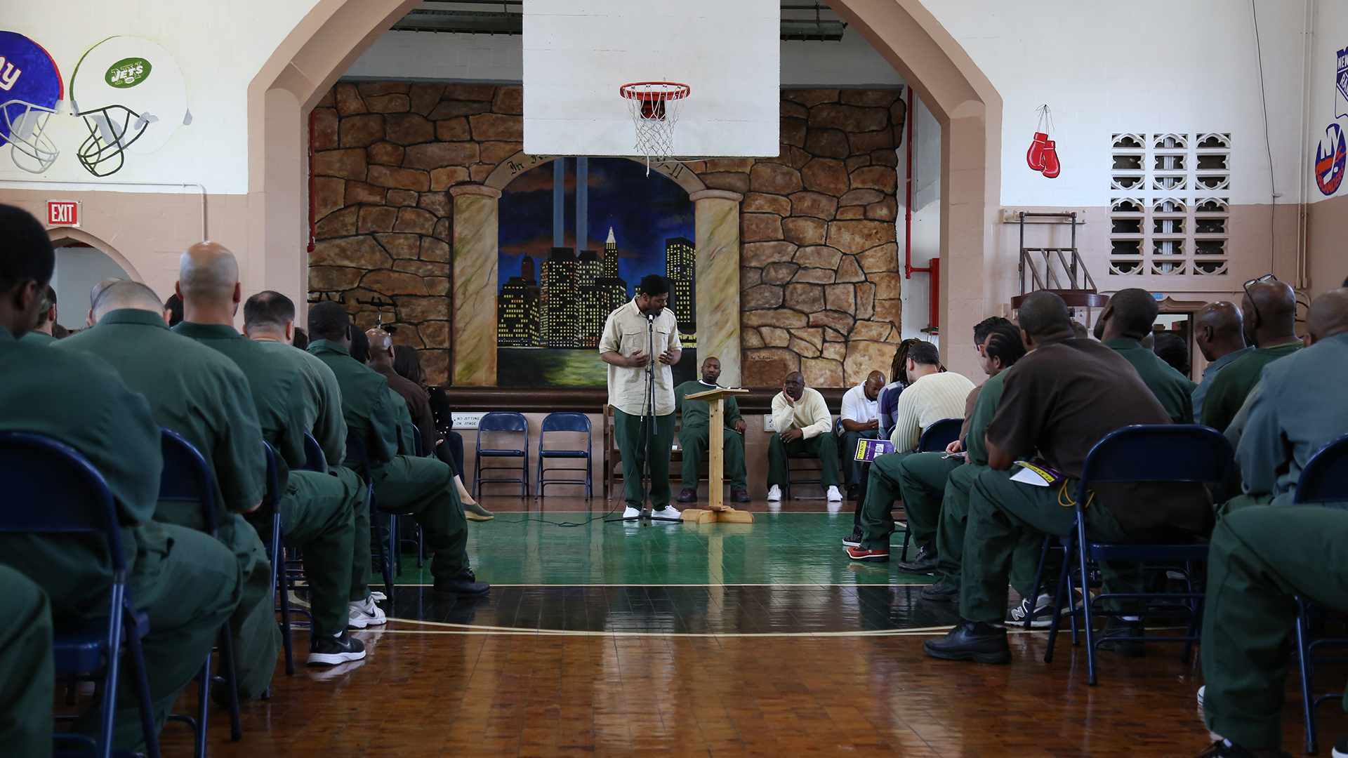 NYU students in gymnasium for event at Wallkill Correctional Facility