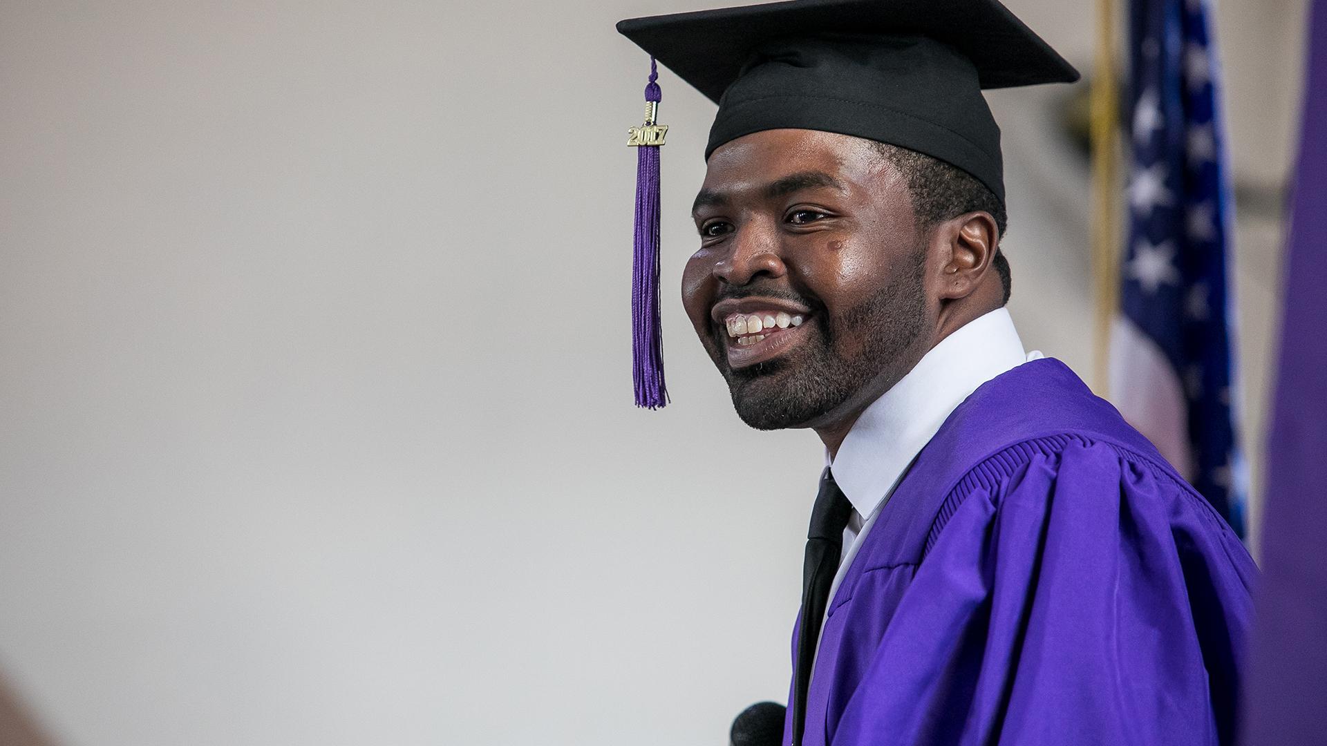 NYU graduate at first graduation ceremony at Wallkill Correctional Facility